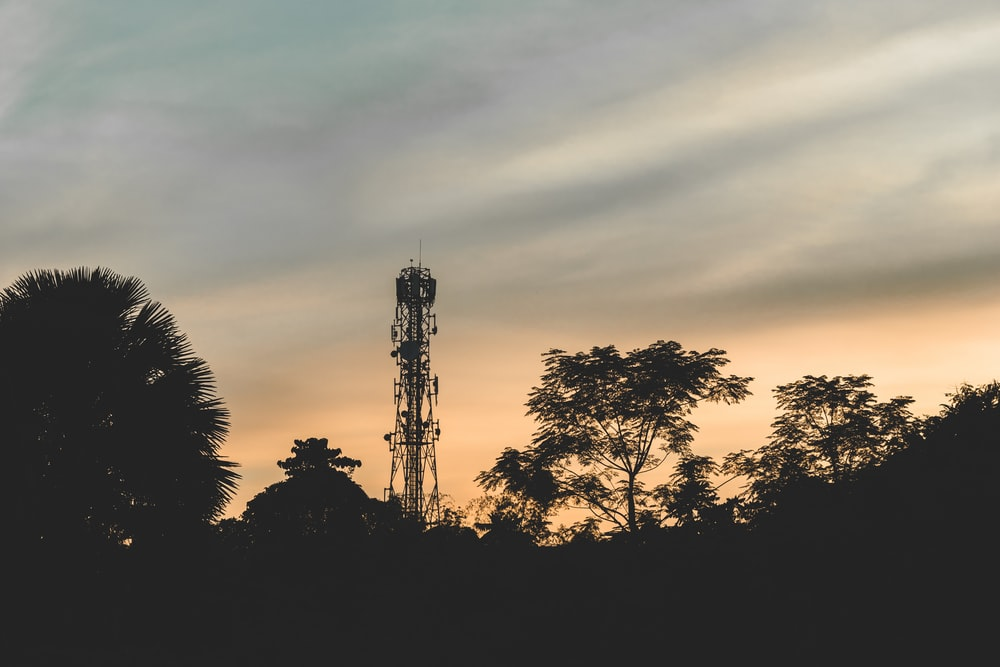 silhouette photography of tower during golden hour