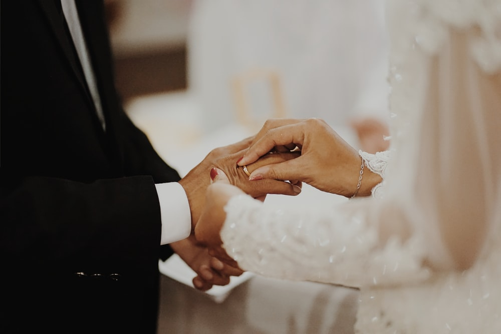 newly wed couple wearing ring