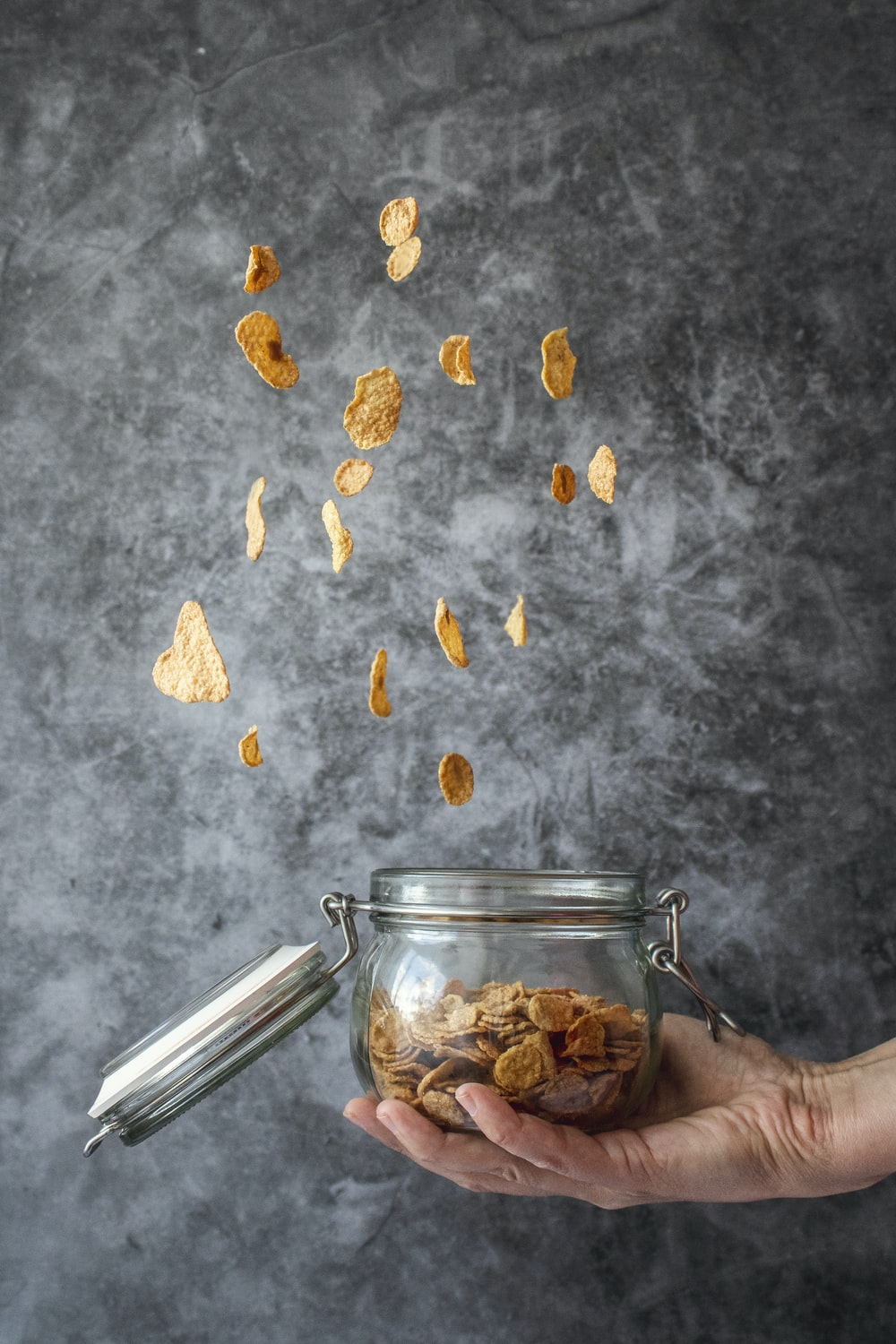 person holding jar of cereals