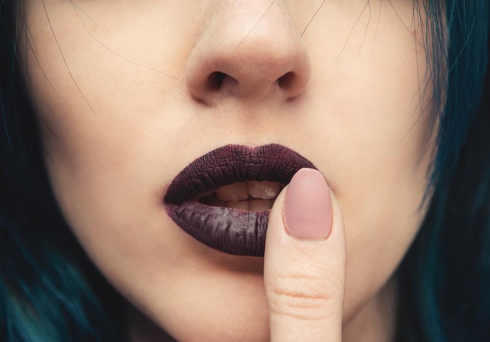 woman wearing black lipstick