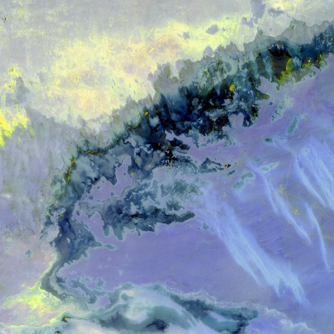 This Landsat image looks like a bold watercolor. Yellow dances across the darkness with muted violet underneath. With a kind of science-fiction flair, this scene shows a portion of the Qattara Depression in Egypt.
