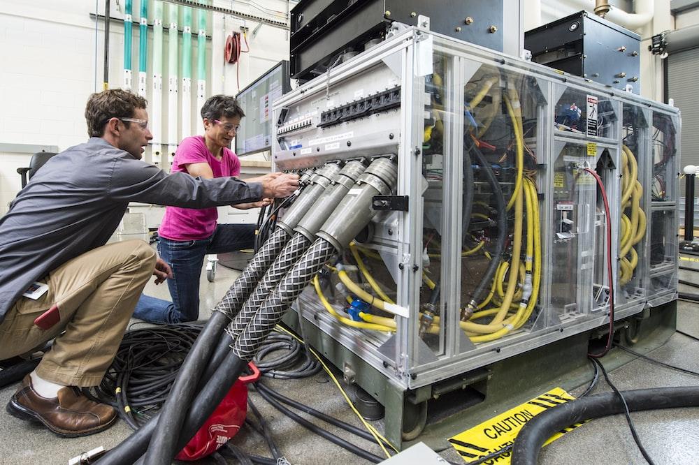 man fixing computer hub