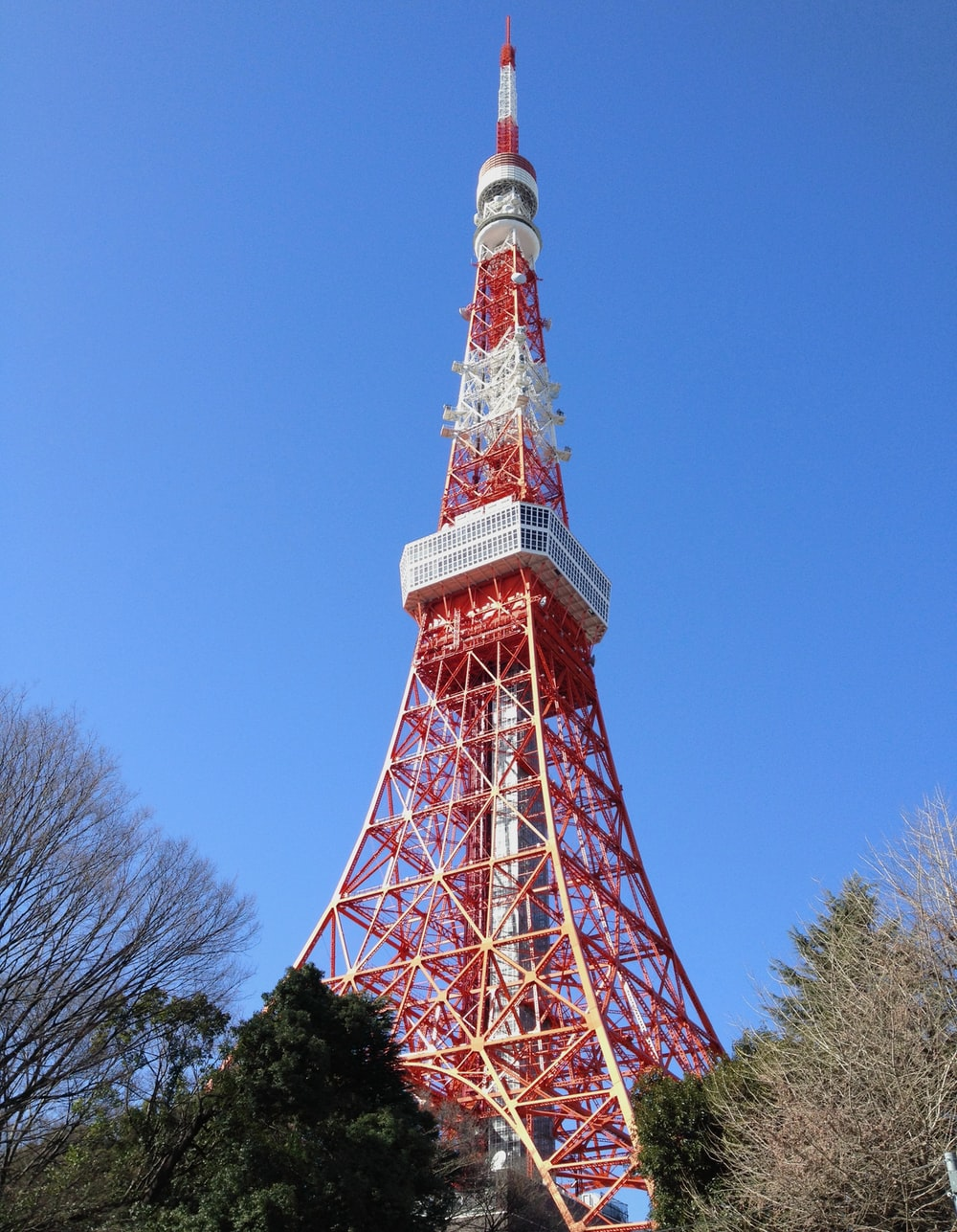 low angle photo of red and white tower