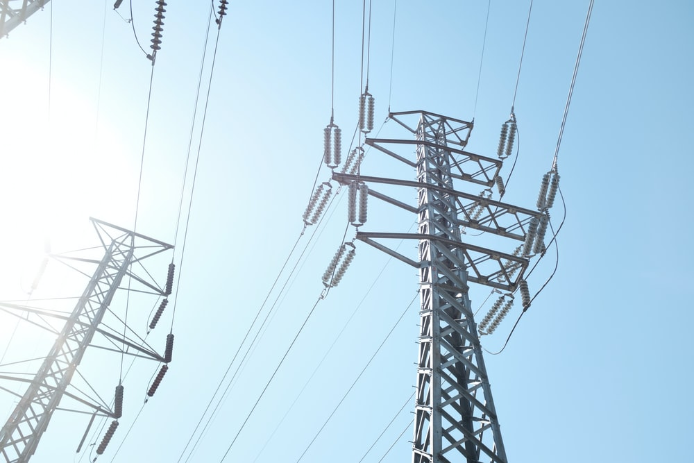 low angle photo of transmission post