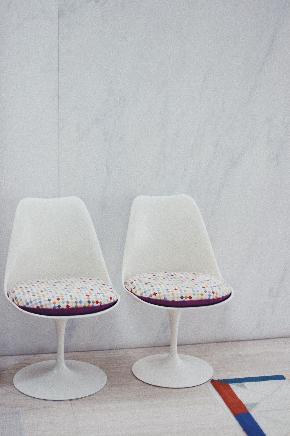 white and multicolored padded armless chairs