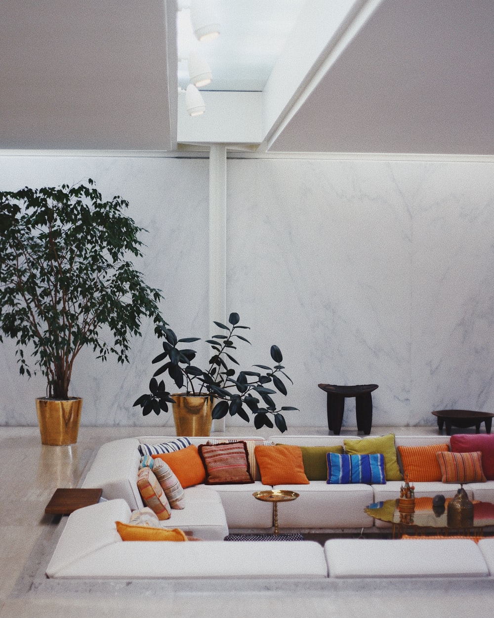 white sectional couch with assorted-colored throw pillows on top