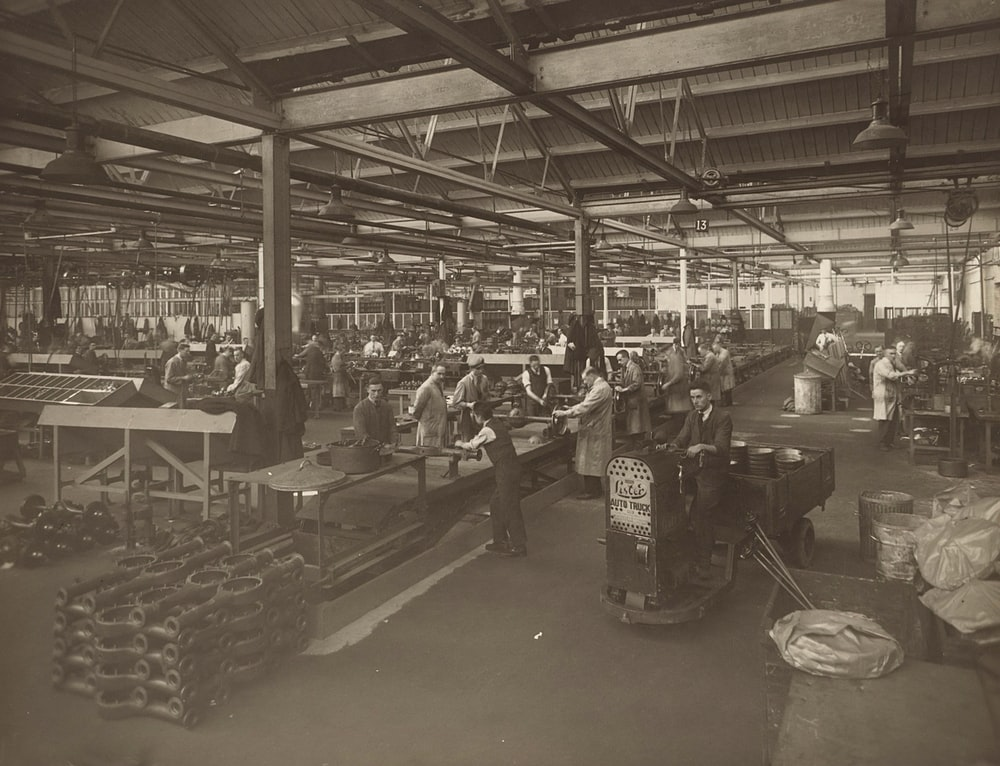 grayscale photo of people in a store