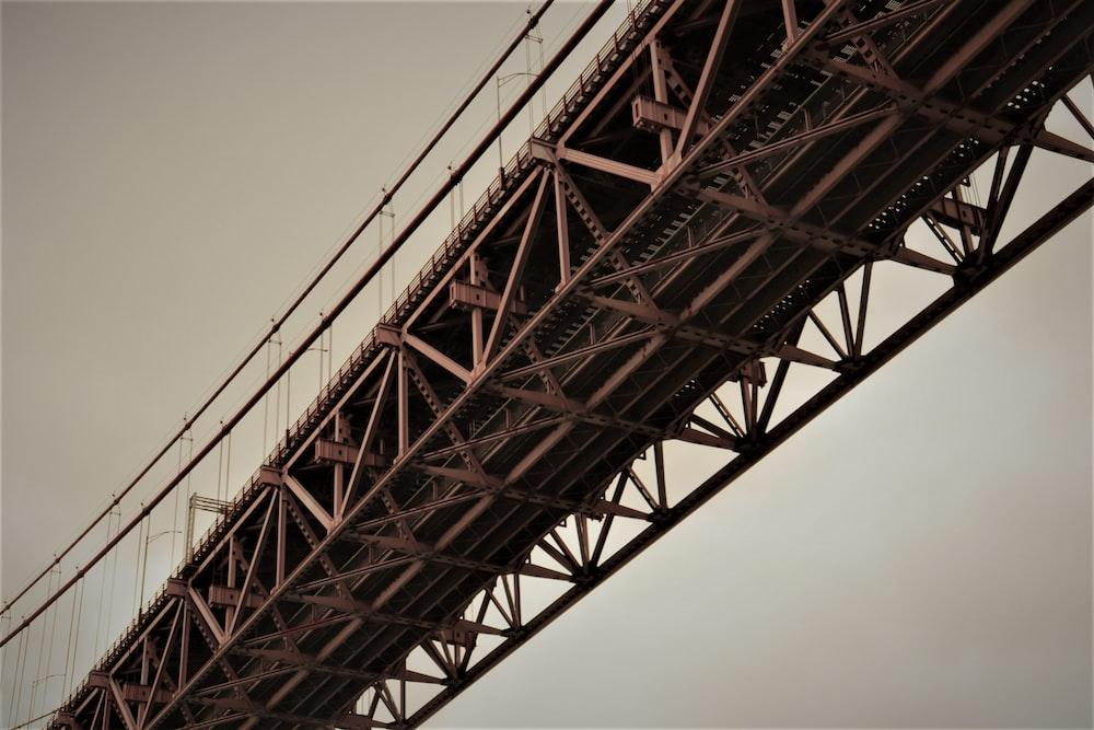 red concrete bridge under gray skies