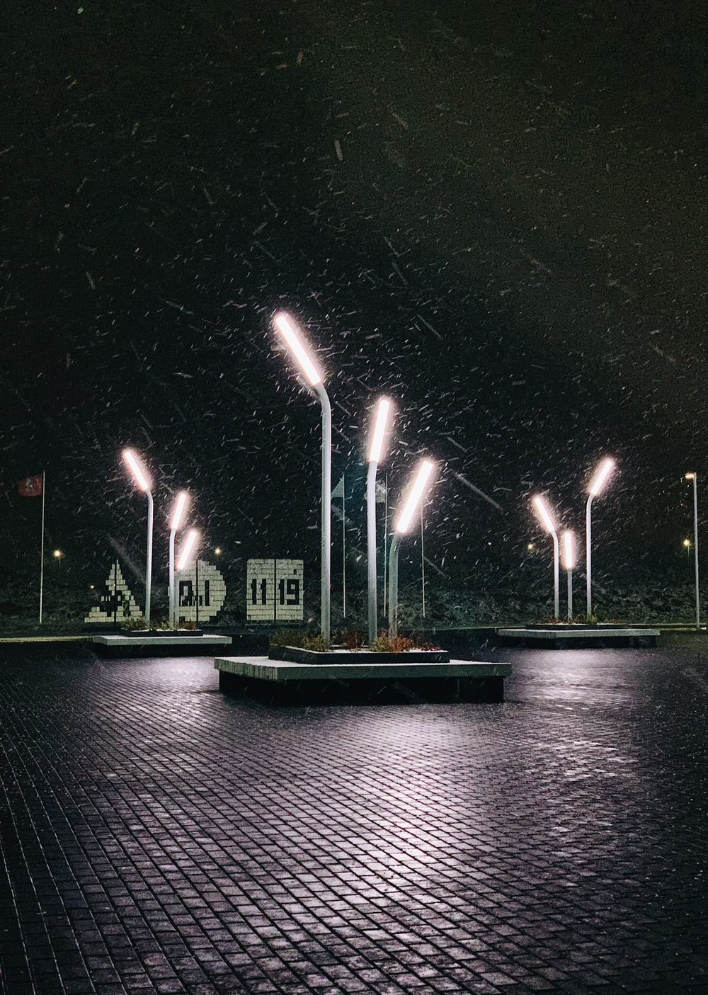 park showing lighted lamp post during night time
