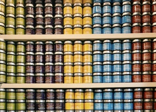 green, brown, yellow, blue, and red labeled jars