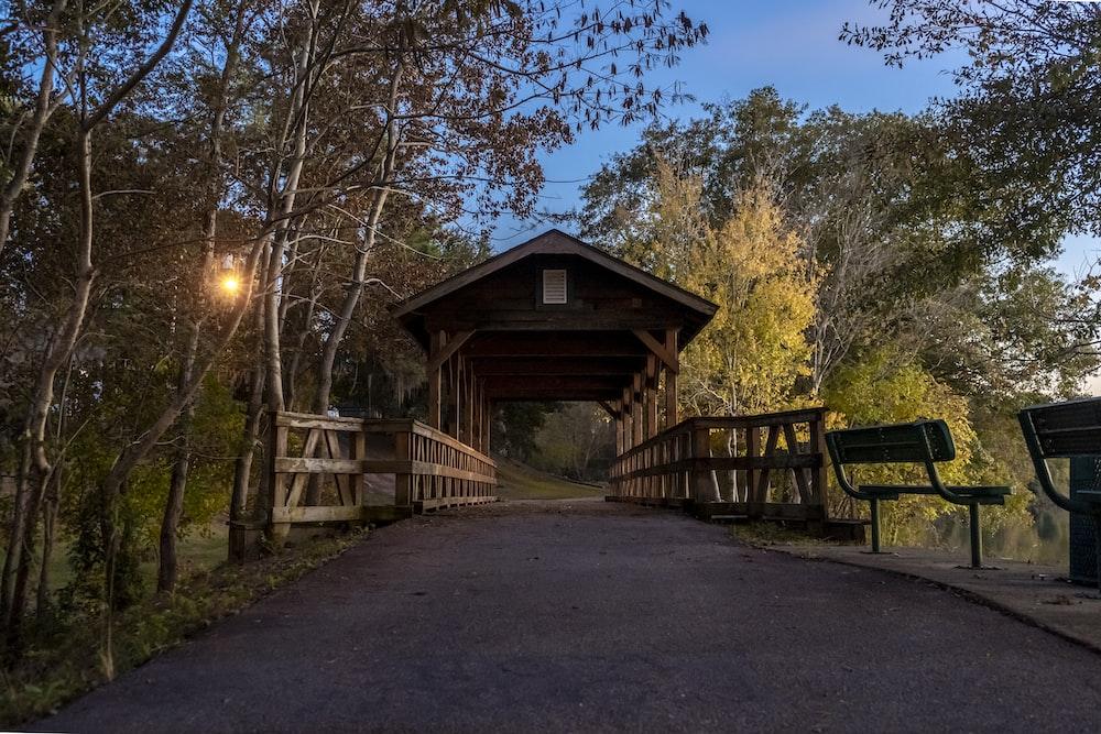 brown wooden bridge with roof