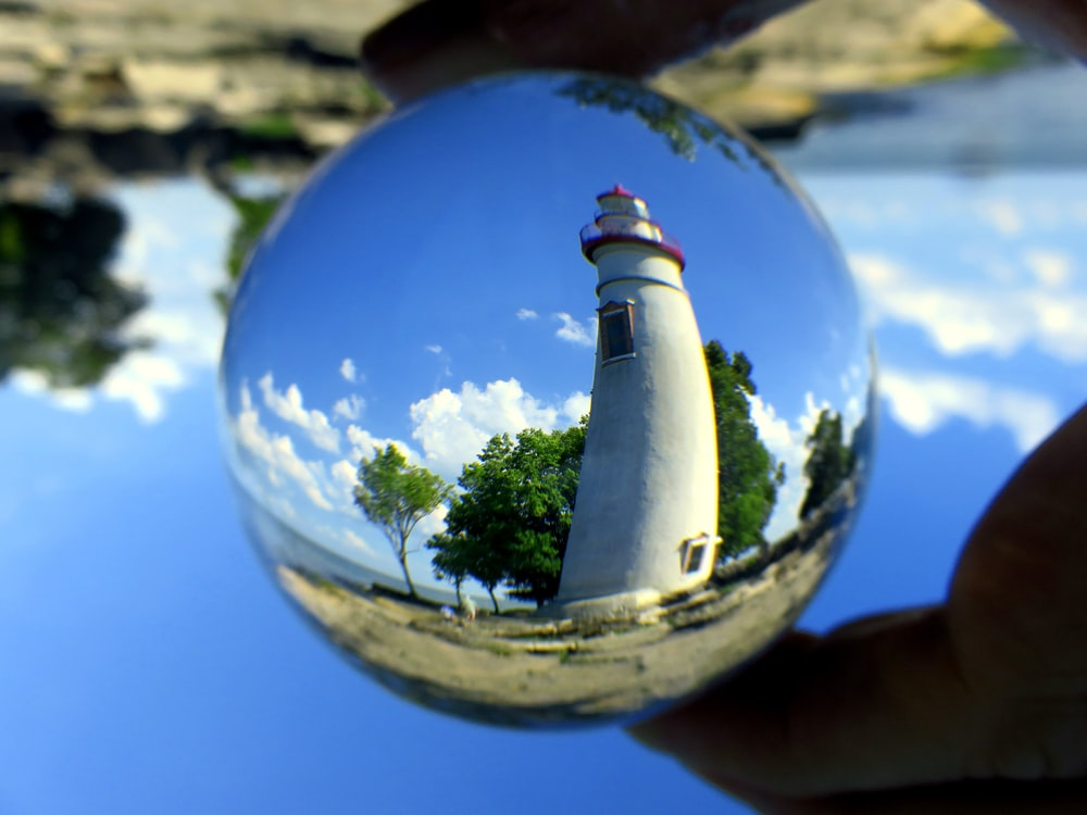 shallow focus photo of white lighthouse