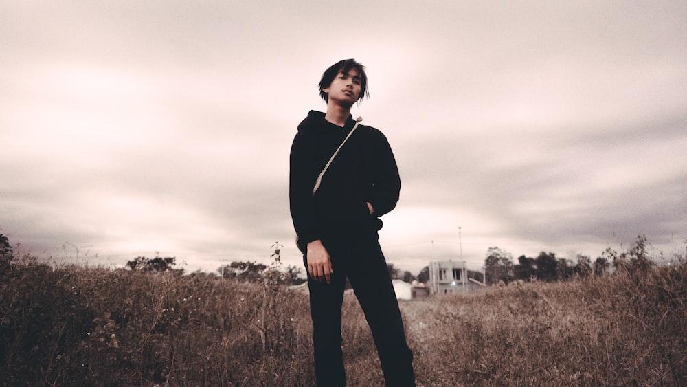 man in black hoodie in grass field