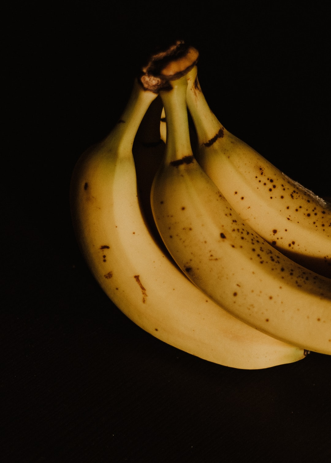 A close up of a spotted banana