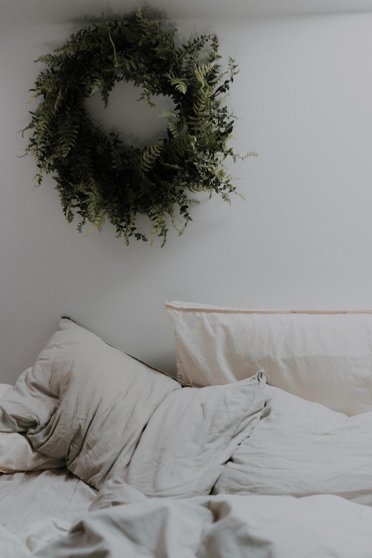 green wreath on wall near bed