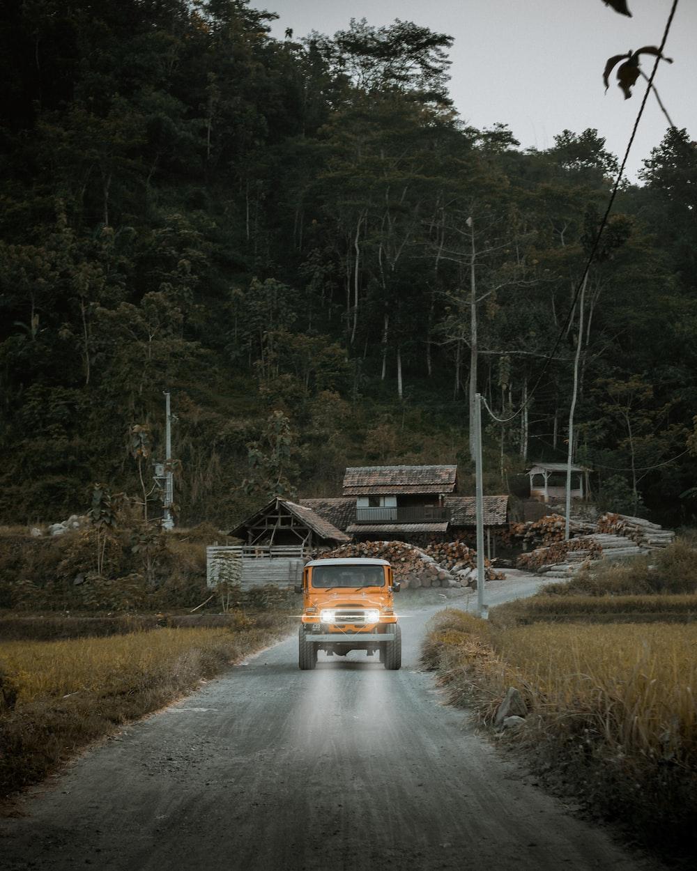 orange Jeep Wrangler on road