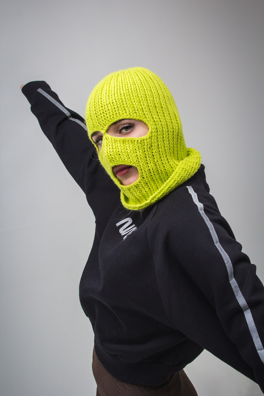 woman in black jacket with yellow ski mask