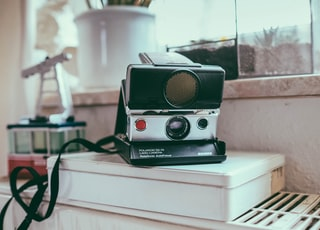 white and black instant camera
