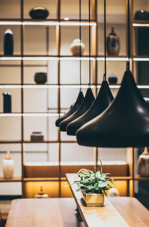 round black pendant lamps on rectangular brown wooden kitchen island
