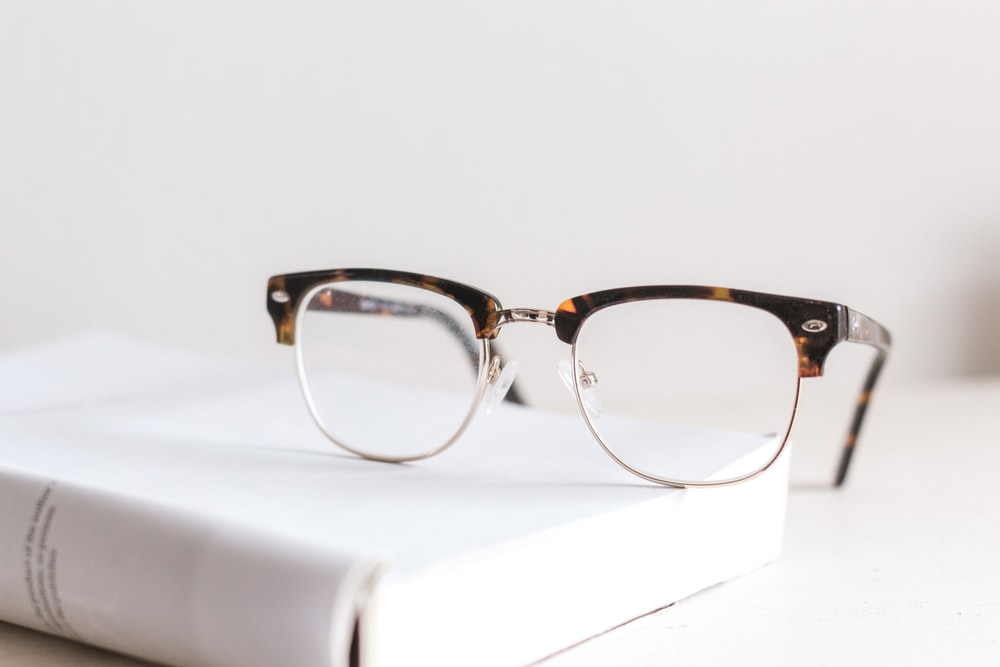 clear eyeglasses on book