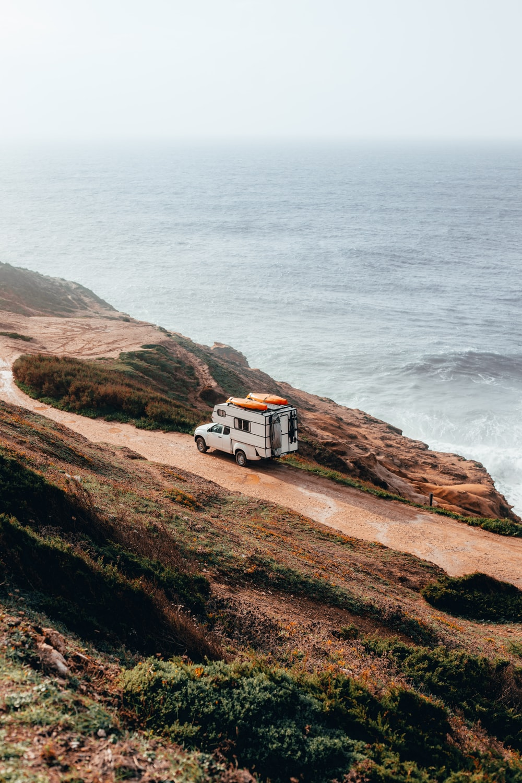 camper trailer on cliff near sea