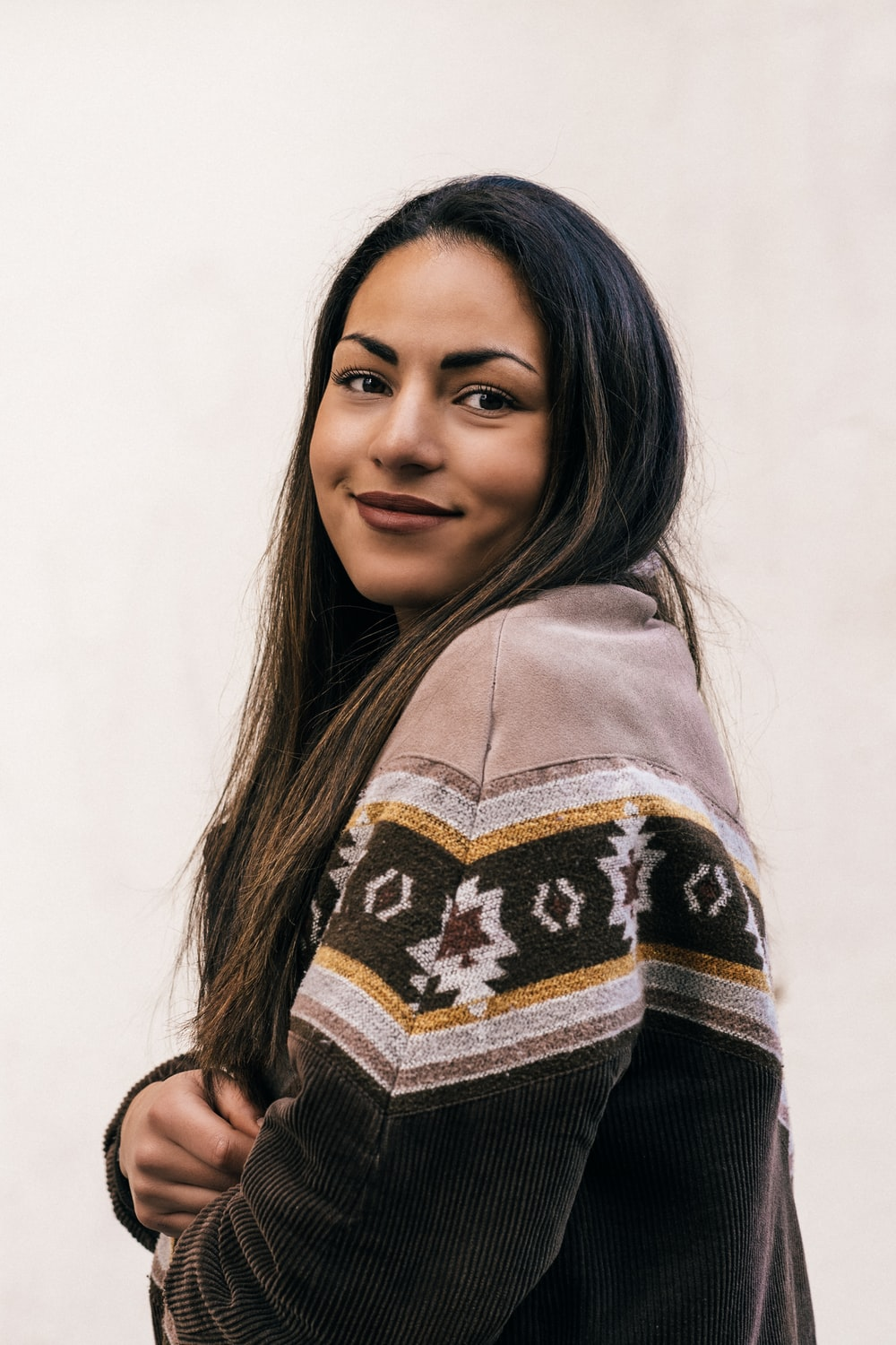 woman wearing green, white, and yellow sweater