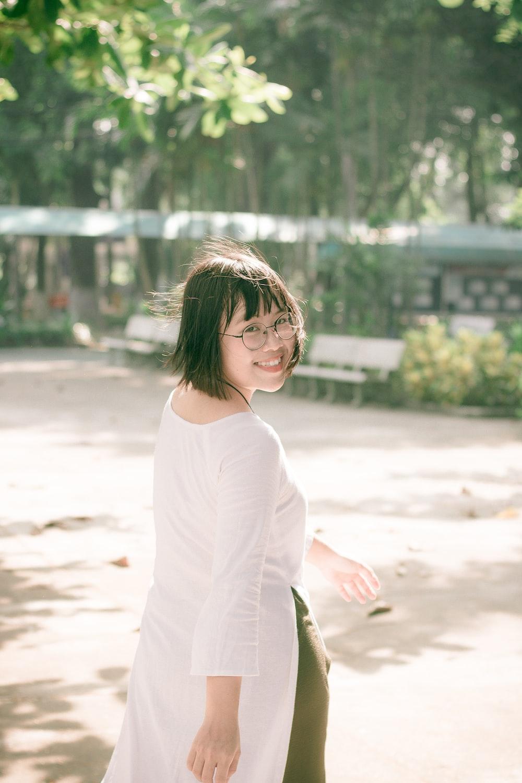 woman walking on road near bench