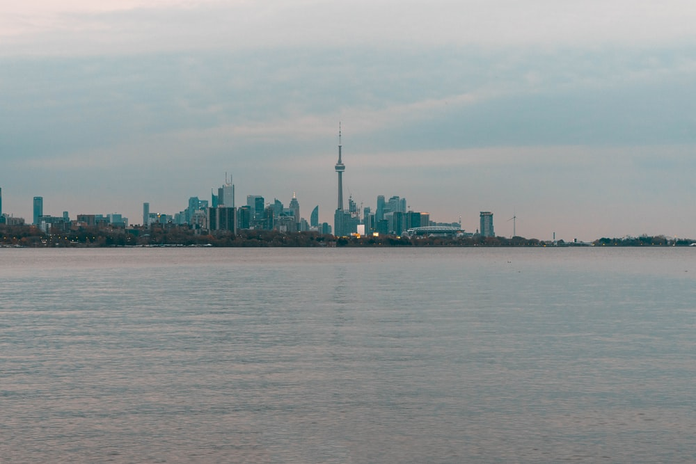landscape photography of city surrounded with body of water