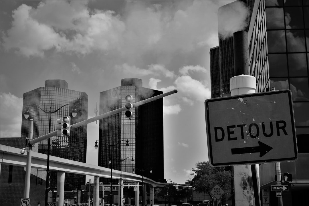 Steam billows out behind a detour sign in downtown Detroit