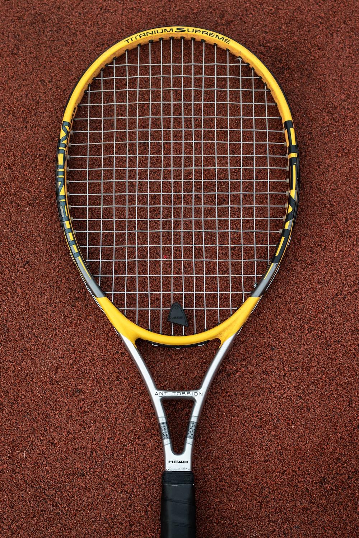 yellow and white badminton racket
