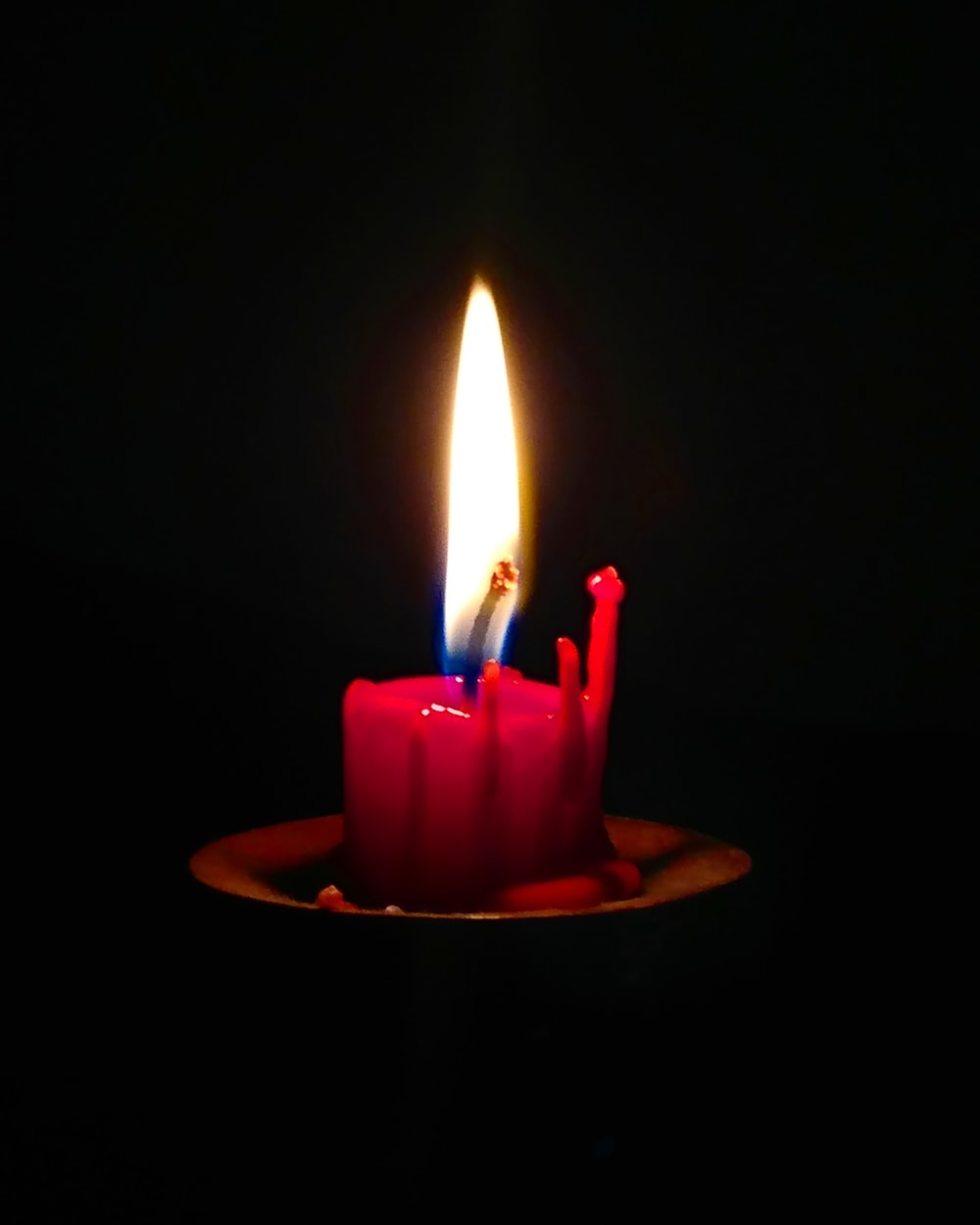red candle on tabletop