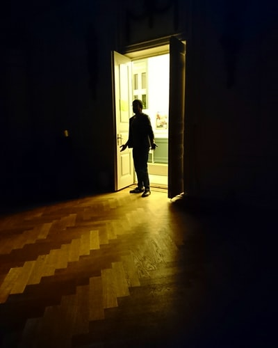 man entering room