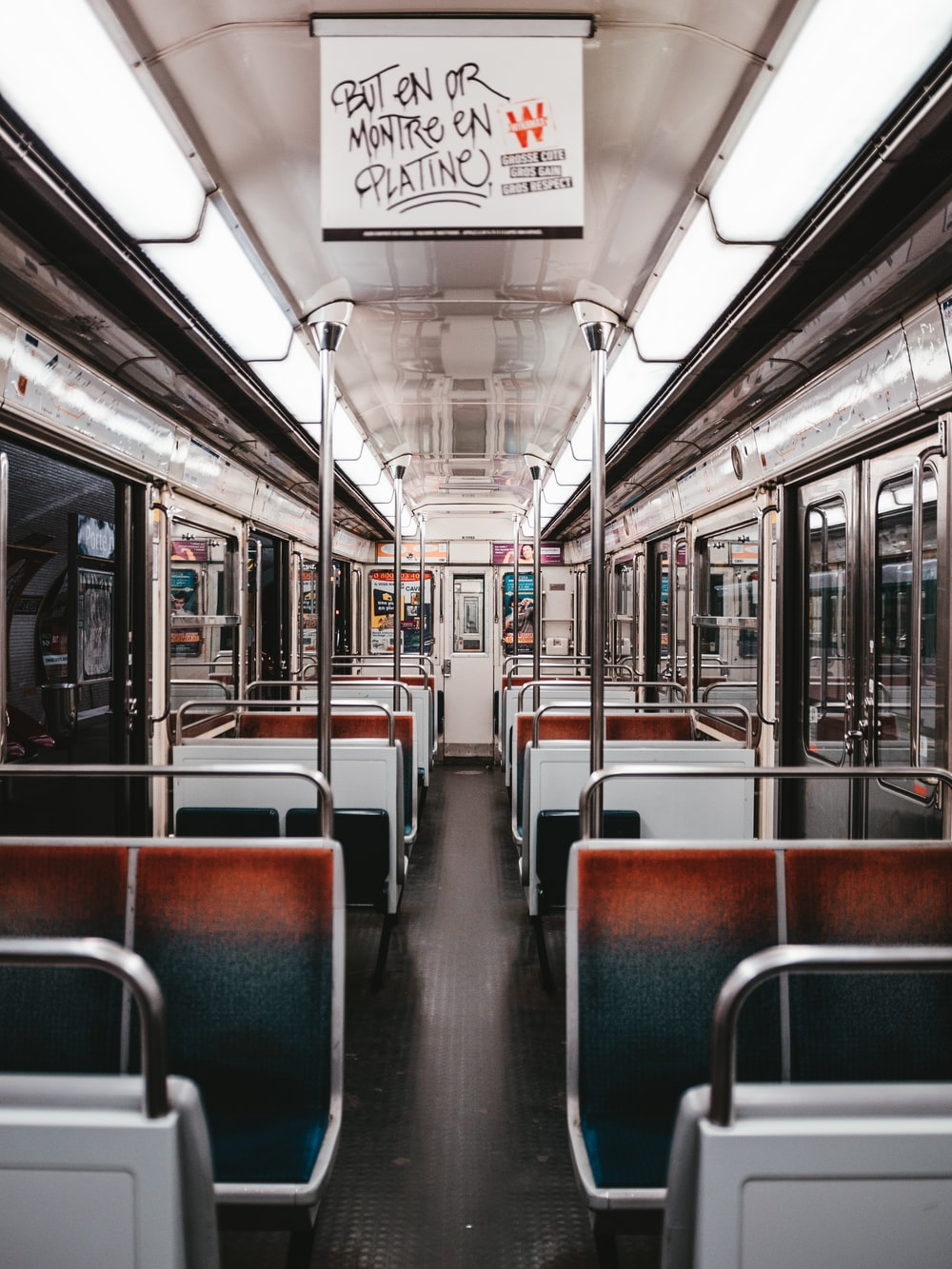 brown and teal subway train seats
