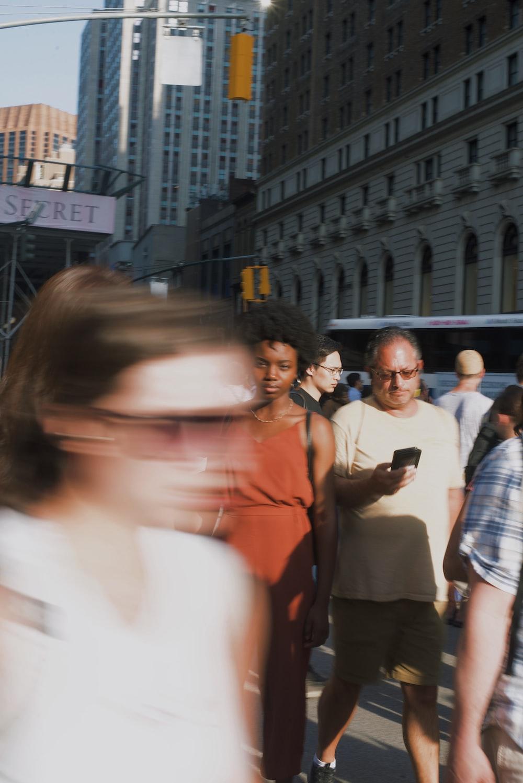 people walking near building