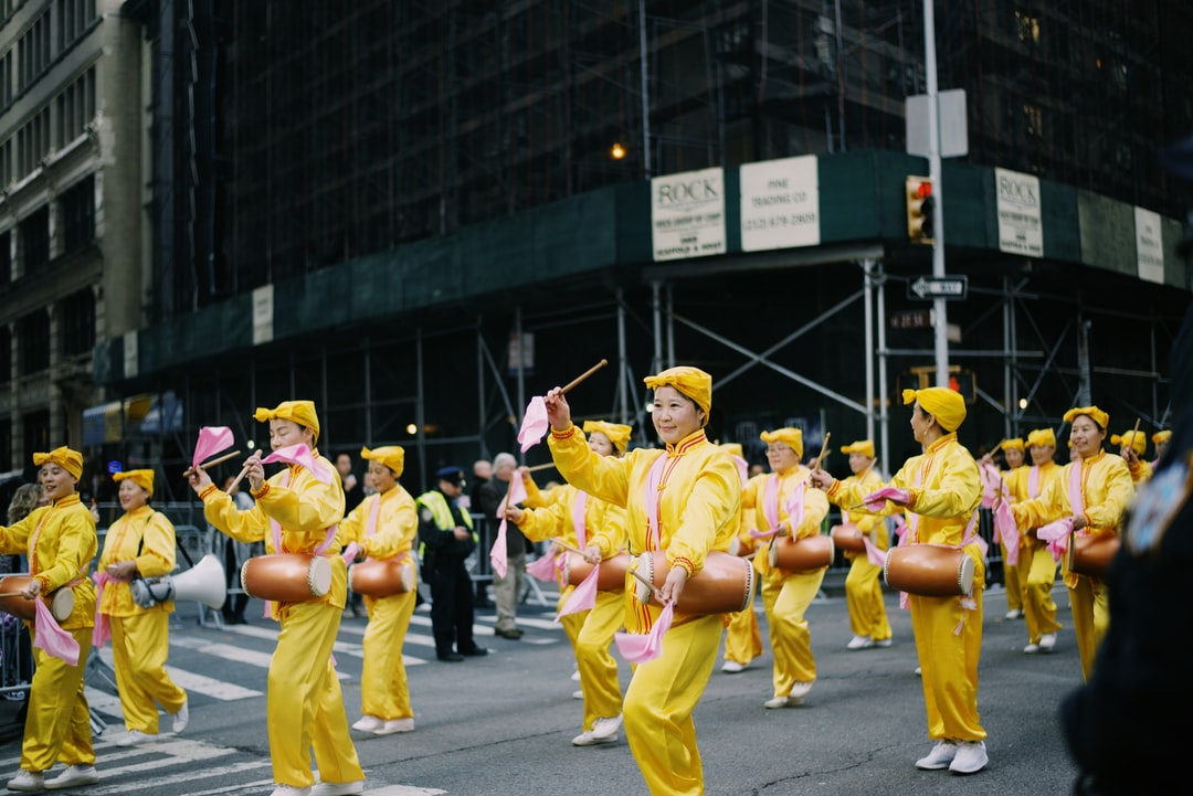 Falun Gafa practitioners in the NYC Veterans Day Parade shot by photographer, Julian Myles