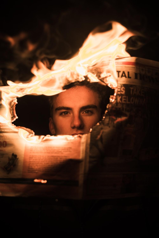 man holding newspaper