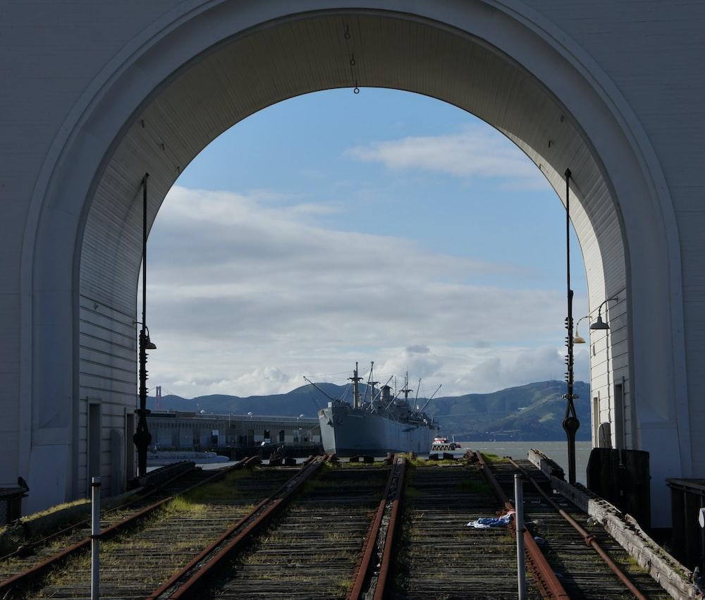gray vessel docked on docking area