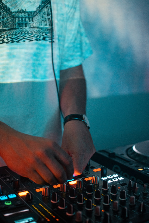 person using DJ mixer