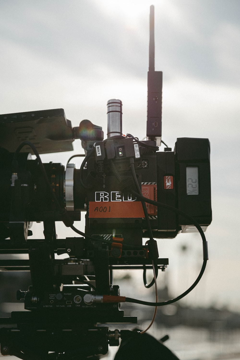 selective focus photo of filming camera