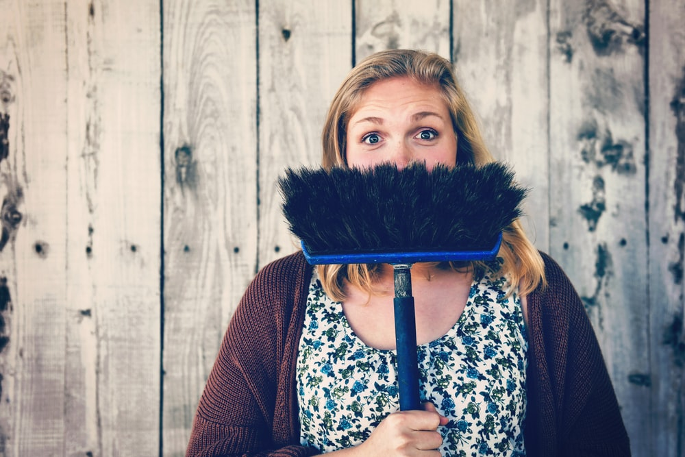 woman holding broom