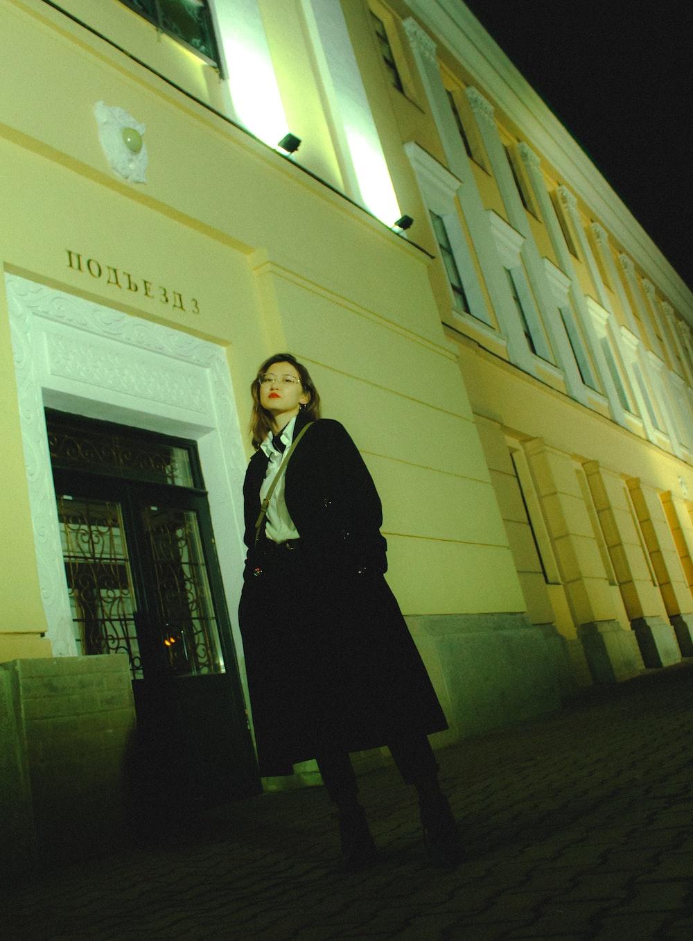 woman standing beside building