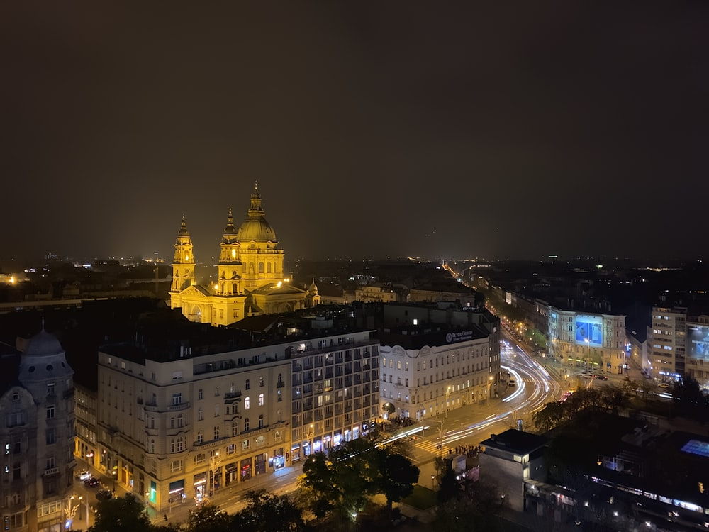wide-angle photography of buildings during nighttime