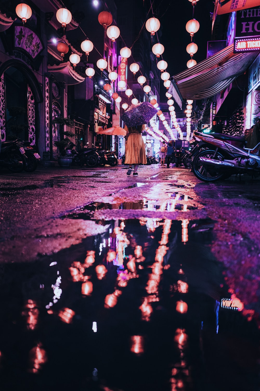 woman under purple umbrella