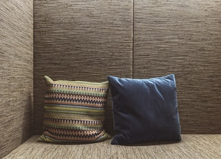 two brown and blue throw pillows