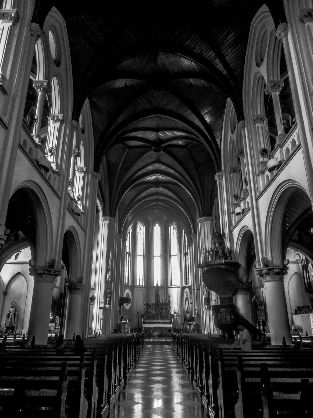 grayscale photo of cathedral interior