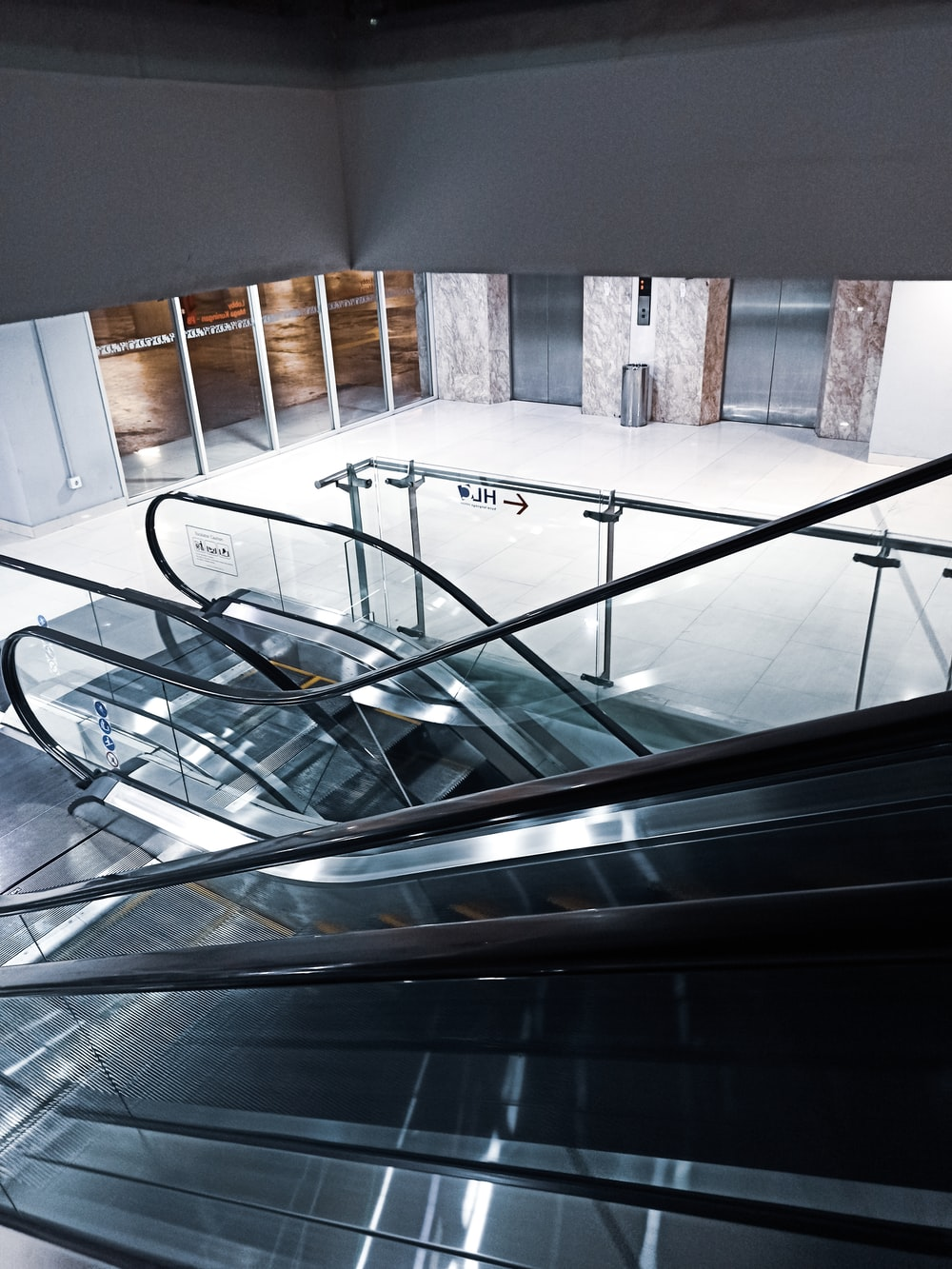 top-view photography of two escalators