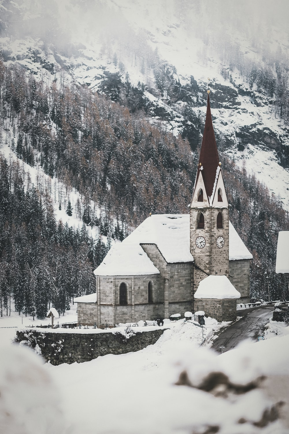 aerial photography of a cathedral covered with snow
