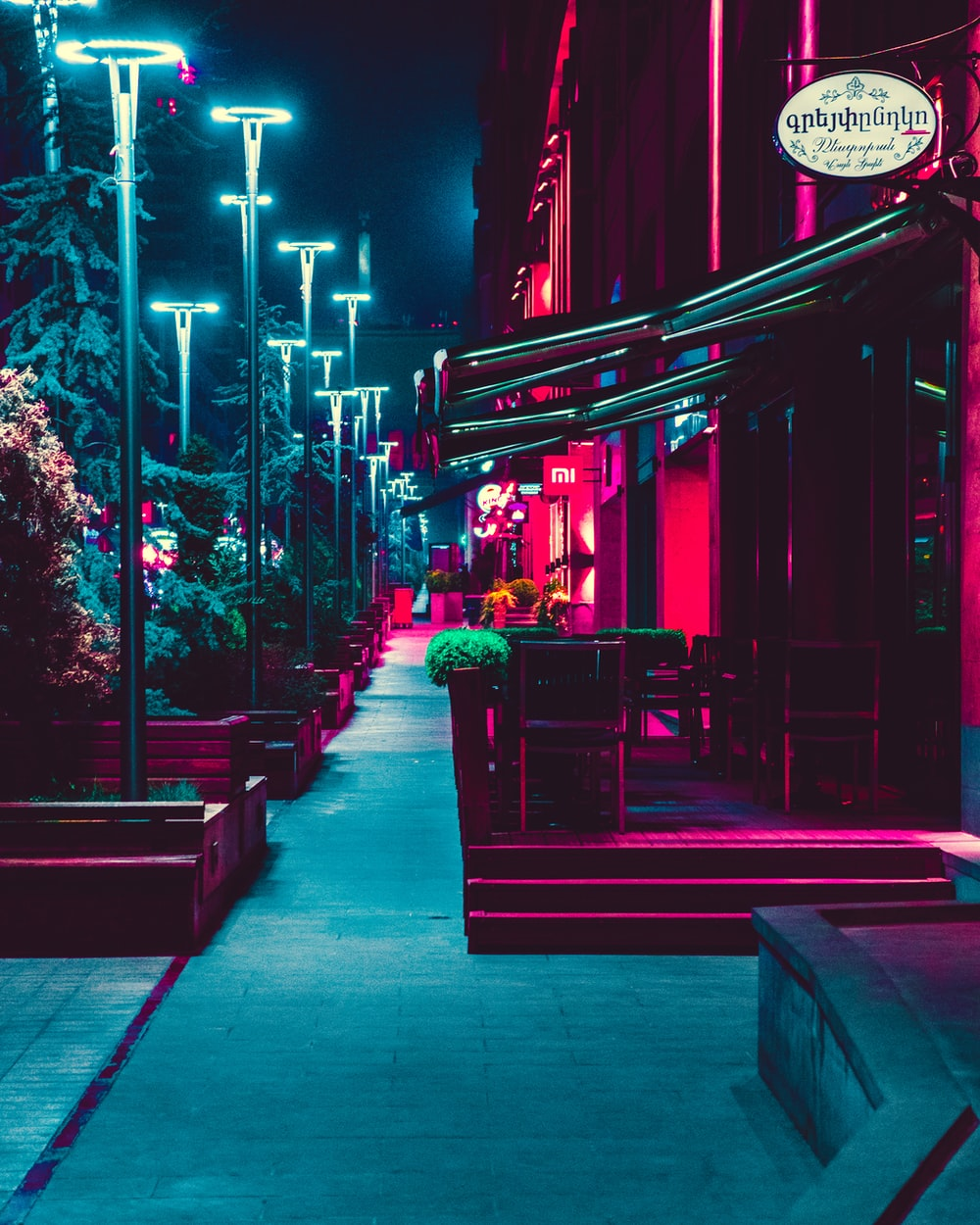 shops and lampposts during night