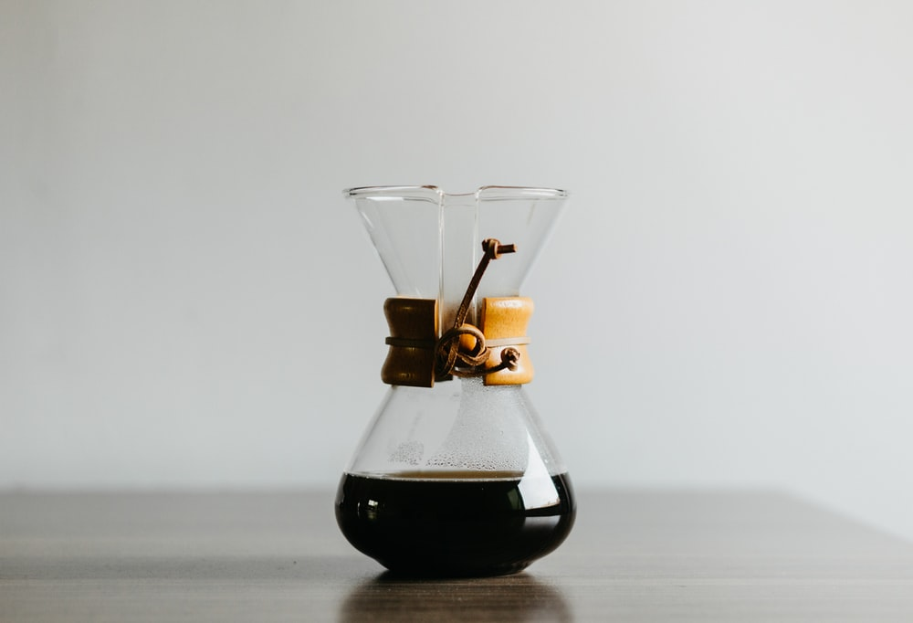 clear glass decanter filled with black liquid
