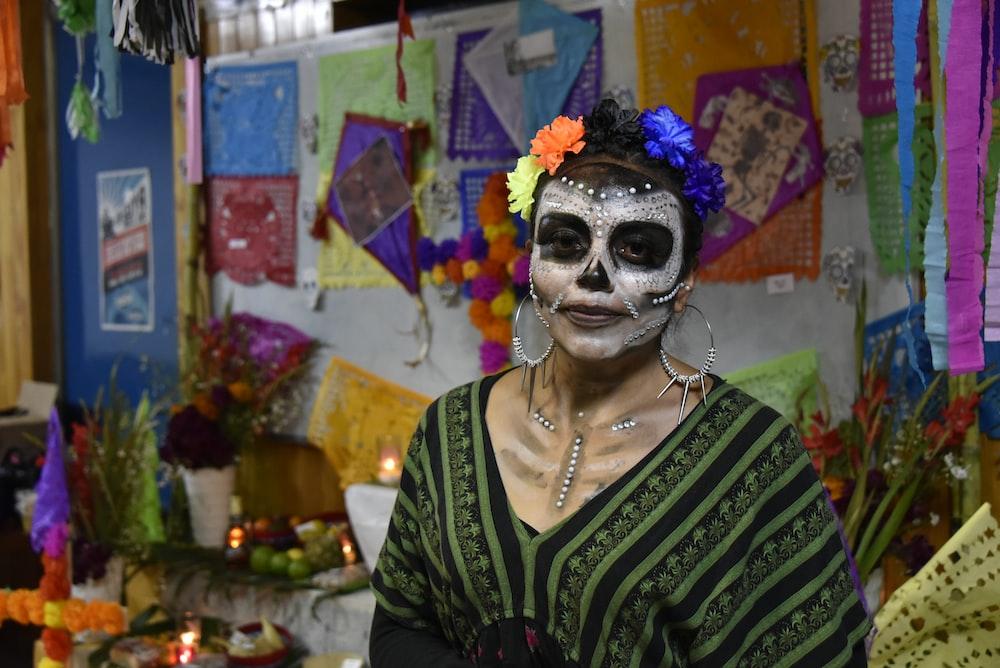 woman wearing calabera mask